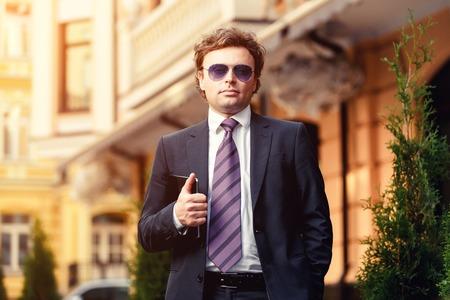 ambitious: Handsome mature caucasian businessman outdoor wearing suit Stock Photo