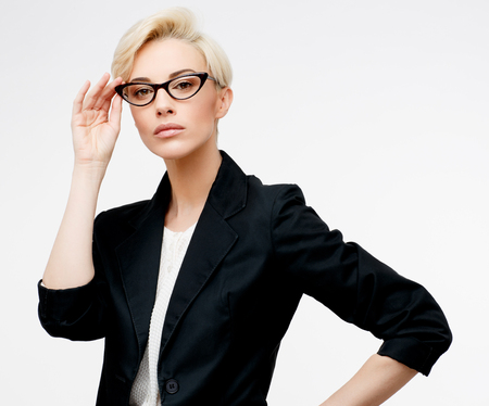 confident business woman: Young beautiful caucasian business woman wearing jacket studio portrait Stock Photo
