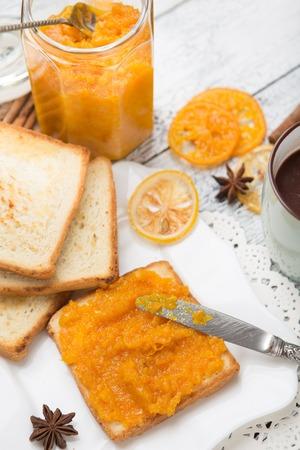 mandarine: toast bread with mandarine jam on vintage wooden table Stock Photo