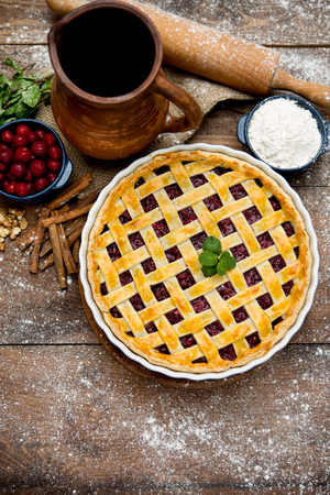 cherry pie: Homemade cherry pie on wooden table. Elevated view