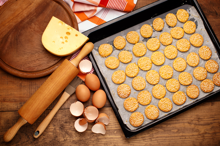 crunchy: Homemade Food - crunchy cheese biscuits on wooden background