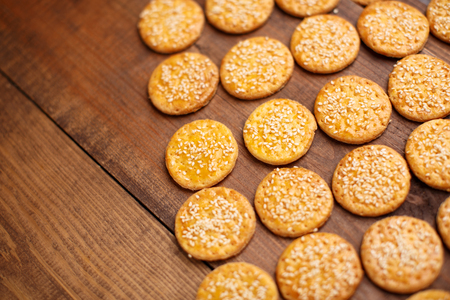 sesame cracker: Homemade Food - crunchy cheese biscuits on wooden background