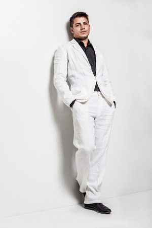 white suit: young man wearing white suit Stock Photo