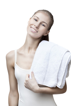 bathtowel: young blond woman with bathtowel isolated on white