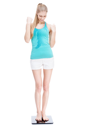 young blond woman standing on scales