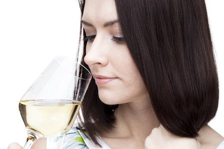 Portrait of beautiful woman with glass white wine Stock Photo