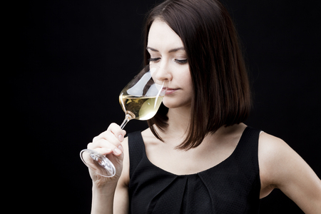 young beautiful woman holding glass of white wine Stock Photo