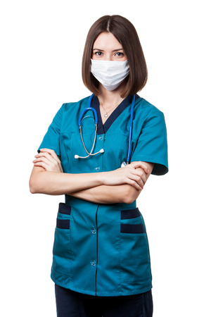 protective mask: young nurse - beautiful brunette woman medical worker with stethoscope wearing protective mask