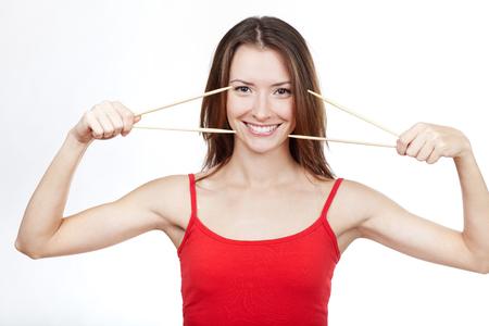 sushi chopsticks: Beautiful brunette woman sushi chopsticks