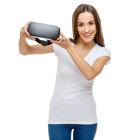 Woman with virtual reality goggles. Studio shot isolated on white