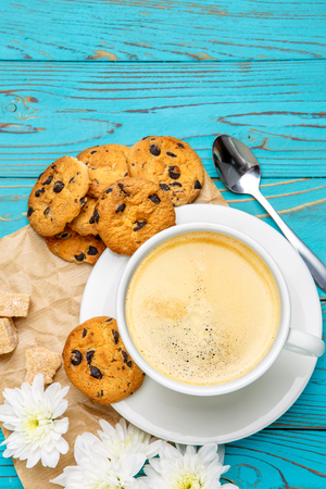 traditionally american: studio shot of fresh cookies and coffee on wooden background