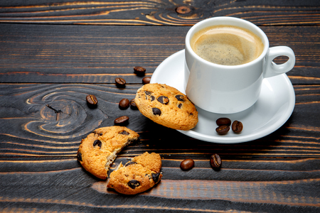 traditionally american: fresh cookies and coffee on wooden background