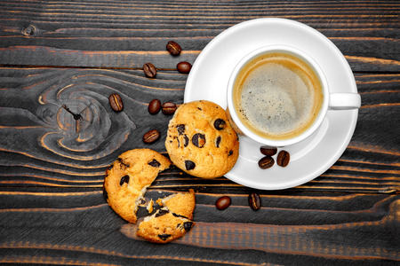 fresh cookies and coffee on wooden background