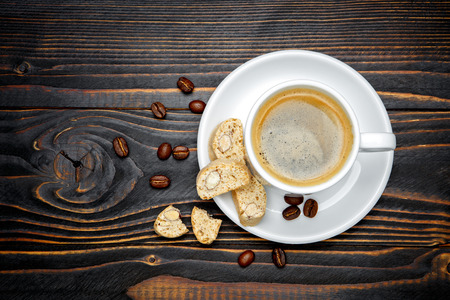 canticcini and coffee on wooden background Stock Photo