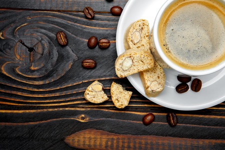 traditionally american: canticcini and coffee on wooden background Stock Photo