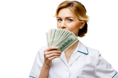 doctor money: Woman doctor standing on white background