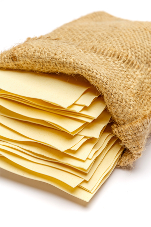 dried uncooked lasagna pasta sheets in bag Stock Photo