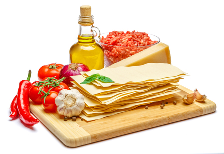 dried uncooked lasagna pasta sheets and vegetables Stock Photo