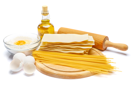 ingridients: pasta and ingridients - lasagna sheets and spaghetti on cutting board