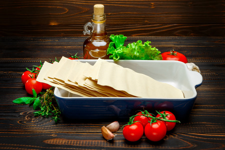 ingridients: dried uncooked lasagna pasta sheets and ingridients Stock Photo