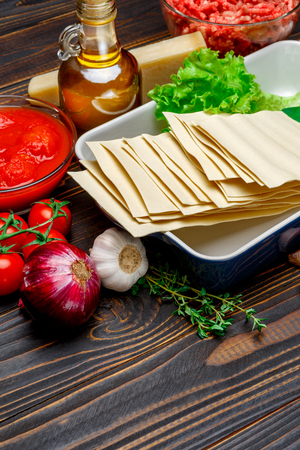 dried uncooked lasagna pasta sheets and ingridients Stock Photo