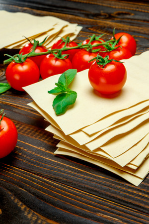 dried uncooked lasagna pasta sheets and tomato