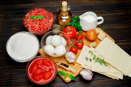 stuffing: lasagna ingridients on wooden table Stock Photo