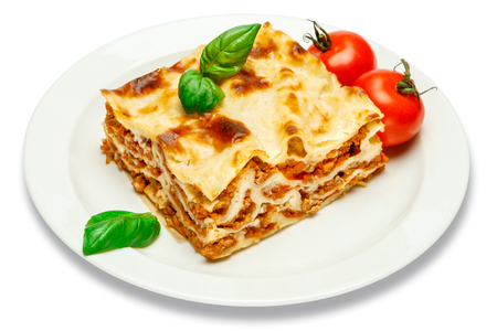 Portion of tasty lasagna isolated on white Foto de archivo