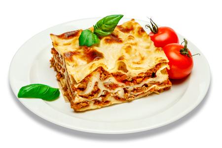 Portion of tasty lasagna isolated on white Standard-Bild