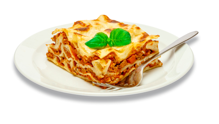 Portion of tasty lasagna isolated on white Stock Photo