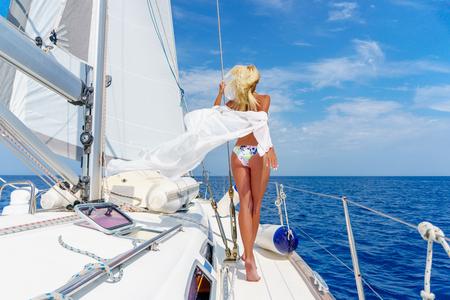 woman relaxing on a cruise boat wearing tunic
