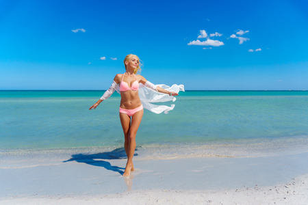 Pretty blonde woman on the beach