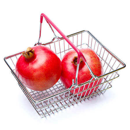 Pomegranate in shopping cart isolated on white. clipping path