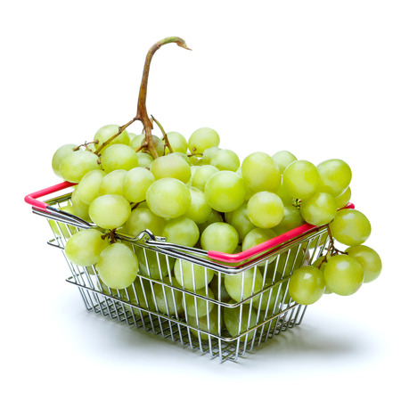 Grapes in shopping cart isolated on white Stock Photo