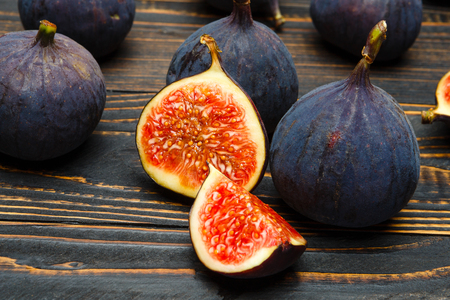 Fresh Organic Figs on wooden background or table