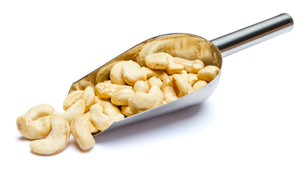 Scoop full of Roasted cashew nuts isolated on white background. Clipping path