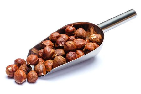 Scoop full of hazelnuts isolated on white background. Clipping path Imagens