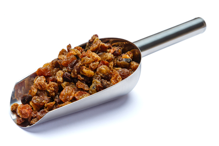 Scoop of raisins isolated on white background. Clipping path