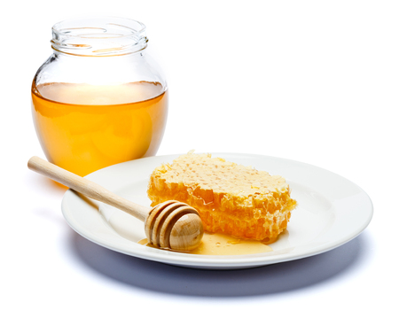 Honeycomb with honey on plate isolated white background Reklamní fotografie - 91668746