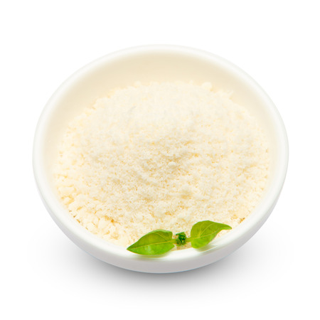 grated Parmesan cheese in ceramic bowl on white background