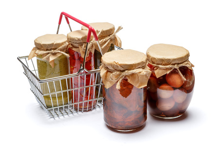 Sundried tomatoes, pepper, capers with oil in glass cans Stock Photo