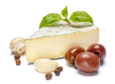 traditional french brie cheese, olives and mushroom on a white background Standard-Bild