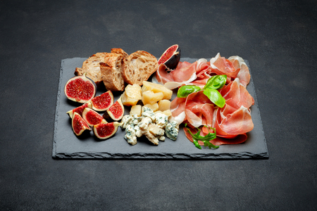 Italian prosciutto crudo or spanish jamon, cheese, figs and bread