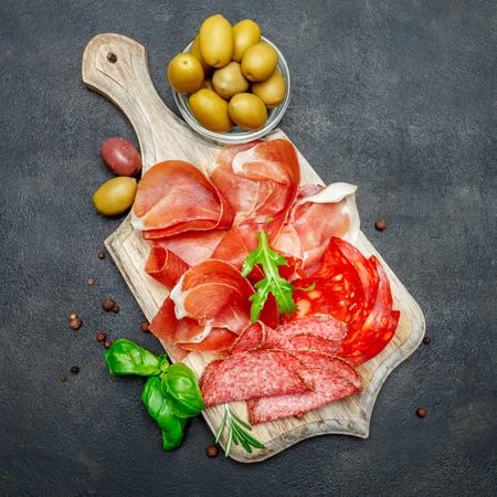 Italian prosciutto crudo or spanish jamon, sausage and olives