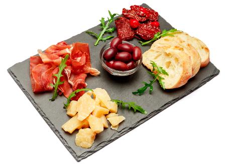Traditional italian meals - prosciutto crudo or jamon, parmesan, tomatoes