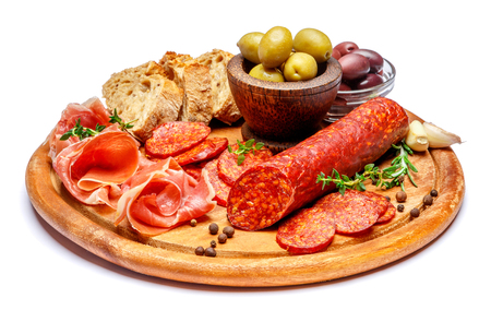 Dried organic salami sausage or spanish chorizo on wooden cutting board 写真素材