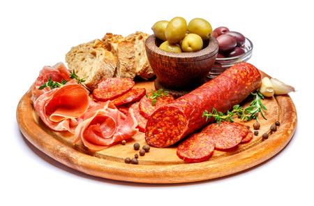 Dried organic salami sausage or spanish chorizo on wooden cutting board Stock Photo