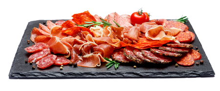 Various types of Dried organic salami sausage and parma on white background
