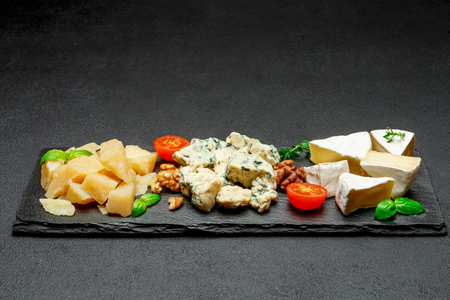 Cheese plate with Assorted cheeses Camembert, Brie, Parmesan blue cheese