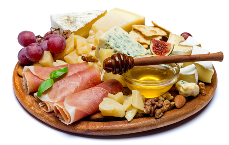 Camembert cheese and prosciutto with honey, figs, walnuts on wooden board